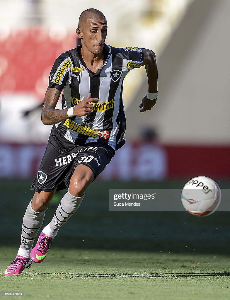 Rafael Marques of Botafogo fights for the ball with during the match between Botafogo and Flamengo as part of Carioca Championship 2013 at Engenhao Stadium on March 03, 2013 in Rio de Janeiro, Brazil.