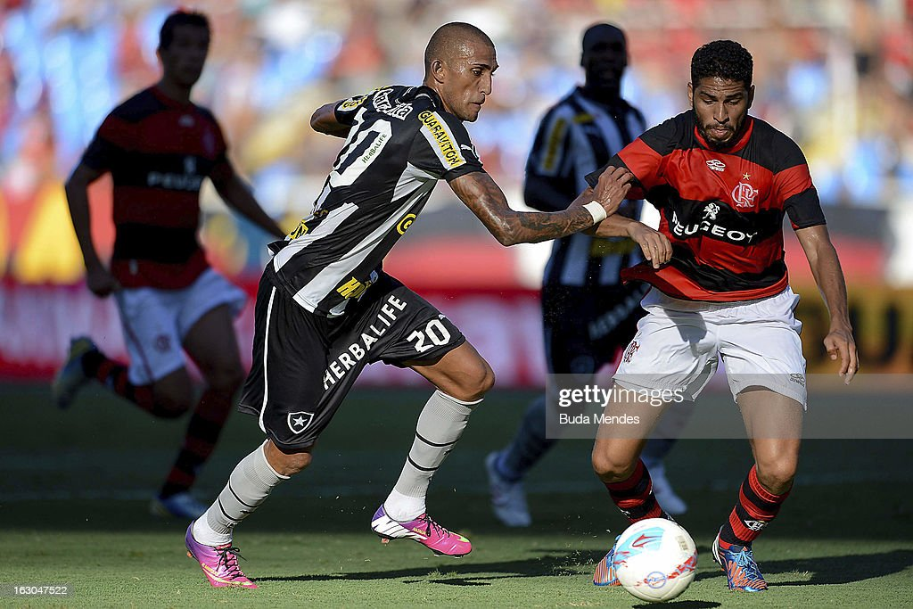 Rafael Marques (L) of Botafogo fights for the ball with Wallace (R) of Flamengo during the match between Botafogo and Flamengo as part of Carioca Championship 2013 at Engenhao Stadium on March 03, 2013 in Rio de Janeiro, Brazil.
