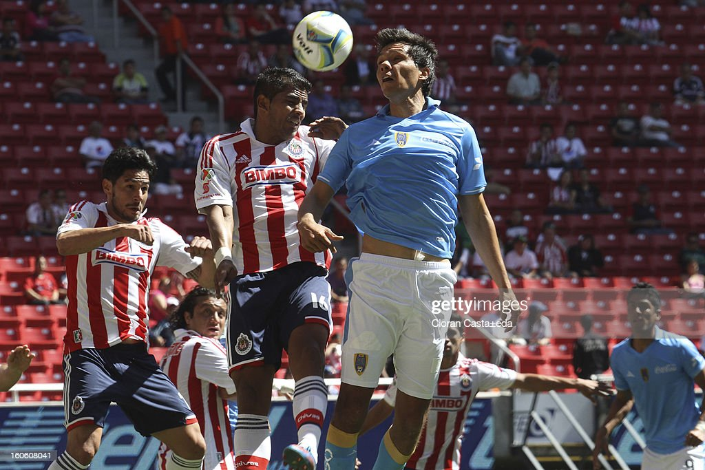 Rafael Marquez and Miguel Angel Ponce of Chivas Guadalajara and Ricardo Adan Jimenez of San Luis fight for the ball during a match of the Clausura Liga MX Round 5 in Omnilife Stadium on February 3, 2013 in Guadalajara, Mexico.