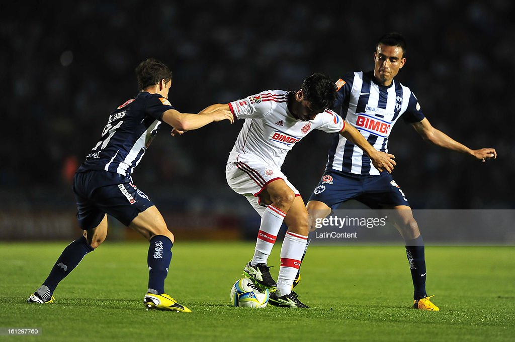 Rafael Marquez fights for the ball with <a gi-track='captionPersonalityLinkClicked' href=/galleries/search?phrase=Hiram+Mier&family=editorial&specificpeople=7361408 ng-click='$event.stopPropagation()'>Hiram Mier</a> and Jesus Zavala during the match between Monterrey and Chivas as part of the Clausura 2013 on February 9, 2013 in Monterrey, Mexico.