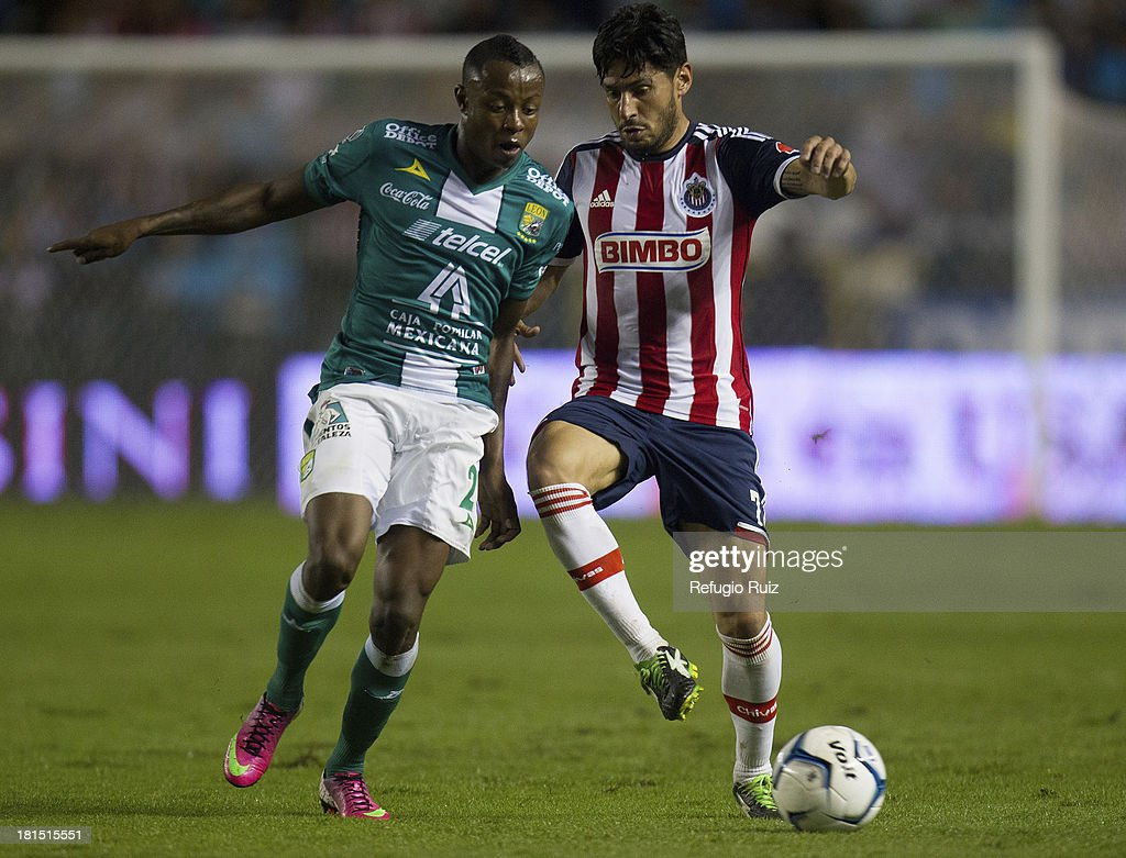 Rafael Marquez Lugo of Chivas fights for the ball with Eisner Lobos of Leon during a match between Leon and Chivas as part of the Apertura 2013 Liga MX at Leon Stadium on September 21, 2013 in Leon, Mexico.