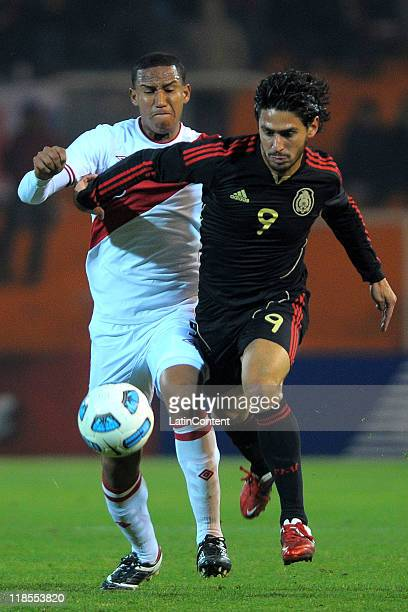 Rafael Marquez Lugo of Mexico struggles for the ball with Adan Balbin of Peru during a match as part of group C of 2011 Copa America at Malvinas...