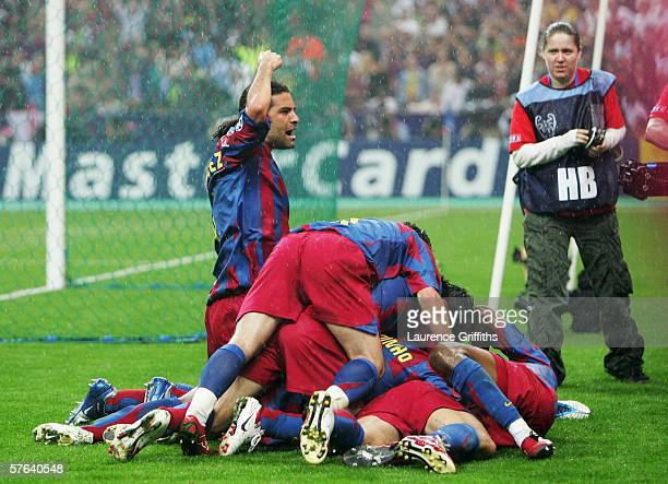 Rafael Marquez of Barcelona salutes the fans as Juliano Belletti is swamped by celebrating team mates after scoring his teams second goal during the...