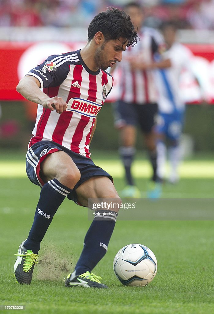Rafael Marquez of Chivas conducts the ball during a match between Chivas and Puebla as part of the Torneo Apertura Liga MX at the Omnilife Stadium on August 18, 2013 in Guadalajara, Mexico.