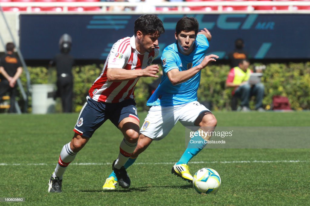 Rafael Marquez of Chivas Guadalajara and Luis Angel Mendoza of San Luis fight for the ball during a match of the Clausura Liga MX Round 5 in Omnilife Stadium on February 3, 2013 in Guadalajara, Mexico.