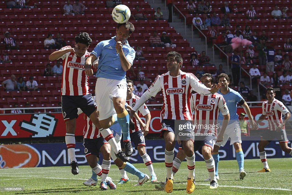 Rafael Marquez (L) of Chivas Guadalajra and Mauro Matos (R) of San Luis Club fight for the ball during a match of the Clausura Liga MX Round 5 in Omnilife Stadium on February 3, 2013 in Guadalajara, Mexico.