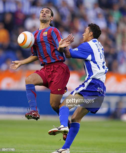 Rafael Marquez of FC Barcelona controls the ball beside Nene of Alaves during a Primera Liga soccer match between Alaves and FC Barcelona at the...