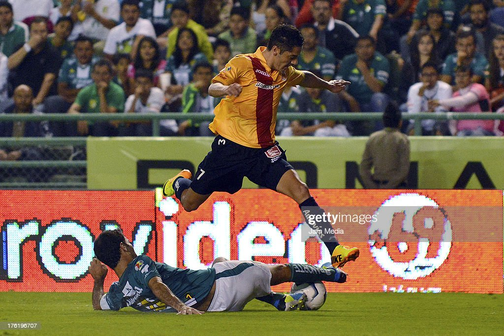 Rafael Marquez (L) of Leon struggles for the ball with Aldo Jose Maria Cardenas (R) of Morelia during the Apertura 2013 Liga Bancomer MX at Nou Camp Stadium on August 10, 2013 in Leon, Mexico.