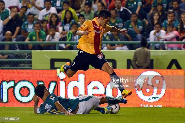 Rafael Marquez of Leon struggles for the ball with Aldo Jose Maria Cardenas of Morelia during the Apertura 2013 Liga Bancomer MX at Nou Camp Stadium...