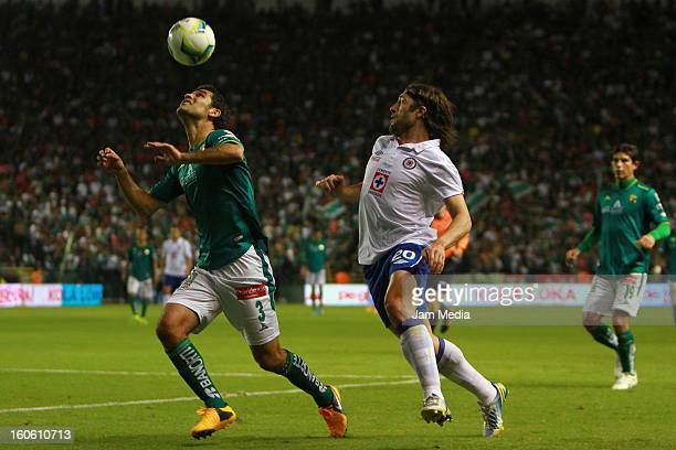 Rafael Marquez of Leon struggles for the ball with Mariano Pavone of Cruz Azul during the Clausura 2013 Liga MX at Nou Camp Stadium on February 2...