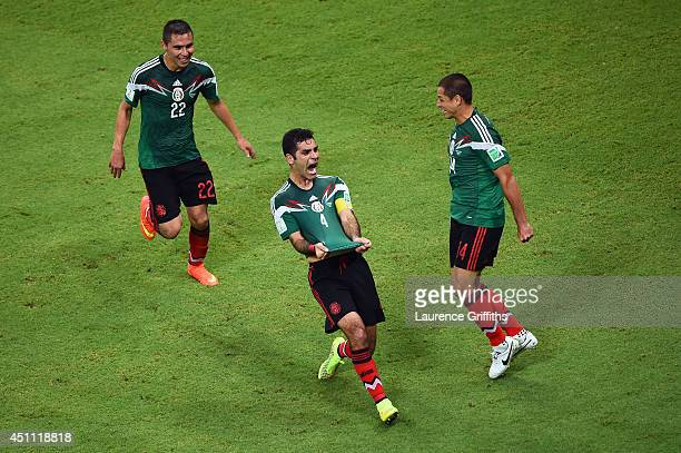 Rafael Marquez of Mexico celebrates scoring his team's first goal during the 2014 FIFA World Cup Brazil Group A match between Croatia and Mexico at...