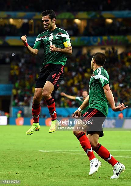 Rafael Marquez of Mexico celebrates scoring his team's first goal with his teammate Javier Hernandez during the 2014 FIFA World Cup Brazil Group A...