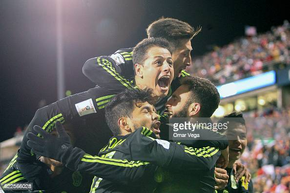 Rafael Marquez of Mexico celebrates with teammates after scoring the second and winning goal of his team during the match between USA and Mexico as...