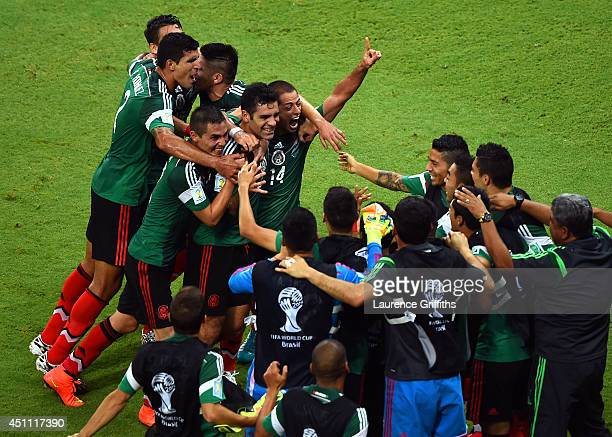 Rafael Marquez of Mexico celebrates with teammates scoring his team's first goal during the 2014 FIFA World Cup Brazil Group A match between Croatia...