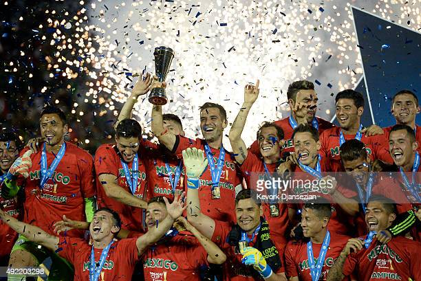 Rafael Marquez of Mexico holds up the trophy as he celebrates with his teammates after defeating the United States 32 during the 2017 FIFA...
