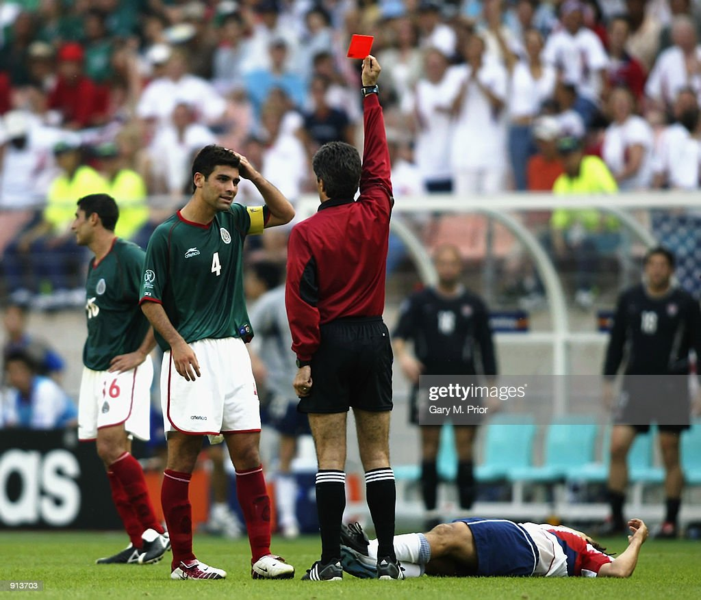 Rafael Marquez of Mexico is sent off by referee Vitor Melo Pereira for a foul on Cobi Jones of the USA during the Mexico v USA, World Cup Second Round match played at the Jeonju World Cup Stadium, Jeonju, South Korea on June 17, 2002. The USA won 2-0.