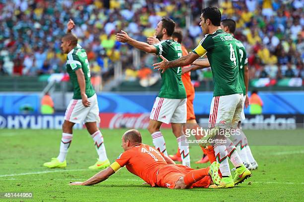 Rafael Marquez of Mexico reacts after a challenge on Arjen Robben of the Netherlands resulting in a yellow card for Marquez and a penalty kick for...