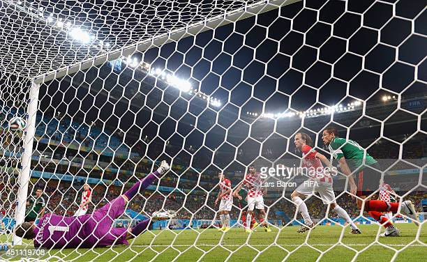 Rafael Marquez of Mexico scores the team's first goal during the 2014 FIFA World Cup Brazil Group A match between Croatia and Mexico at Arena...
