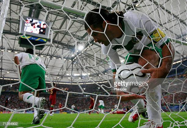 Rafael Marquez picks up the ball out of the net after Jose Fonseca of Mexico won the header and scored their first goal of the game during the FIFA...