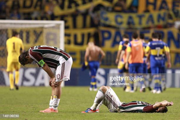 Rafael Moura and Thiago Neves of Fluminense cry after lost a match between Fluminense and Boca Juniors as part of the Copa Libertadores 2012 at Joao...