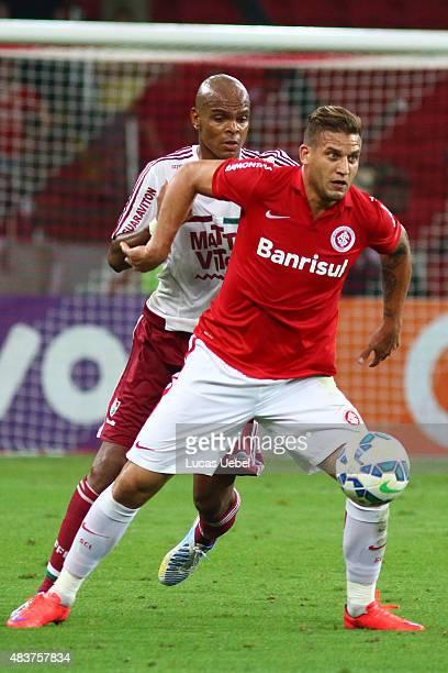 Rafael Moura of Internacional battles for the ball against Marlon Santos of Fluminense during the match between Internacional and Fluminense as part...