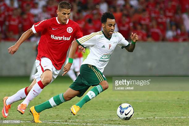 Rafael Moura of Internacional battles for the ball against Wesley of Palmeiras during the match between Internacional and Palmeiras as part of...