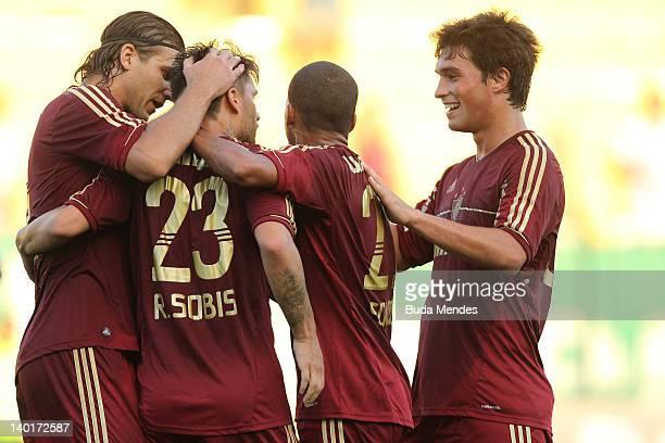 Rafael Moura Rafael Sobis Souza and Jean of Fluminense celebrate a scored goal against Resende during a match between Resende v Fluminense as part of...
