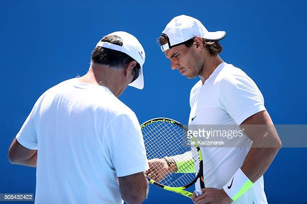 Rafael Nadal and coach Toni Nadal talk in a practice session during day one of the 2016 Australian Open at Melbourne Park on January 18 2016 in...