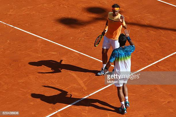 Rafael Nadal and Fernando Verdasco of Spain celebrate their straight sets victory in the doubles against Philipp Kohlschreiber of Germany and Viktor...