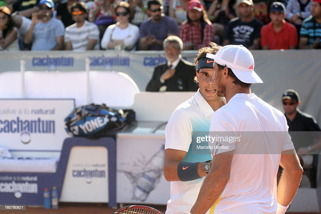 <a gi-track='captionPersonalityLinkClicked' href=/galleries/search?phrase=Rafael+Nadal&family=editorial&specificpeople=194996 ng-click='$event.stopPropagation()'>Rafael Nadal</a> and Juan Mónaco talk during a double tennis match between <a gi-track='captionPersonalityLinkClicked' href=/galleries/search?phrase=Rafael+Nadal&family=editorial&specificpeople=194996 ng-click='$event.stopPropagation()'>Rafael Nadal</a> and Juan Mónaco against Frantisek Cermak and Lukas Dlouhya of Czechoslovak as part of the day 1 of the ATP Viña del Mar VTR Open 2013 on February 05, 2013 in Viña del Mar, Chile.