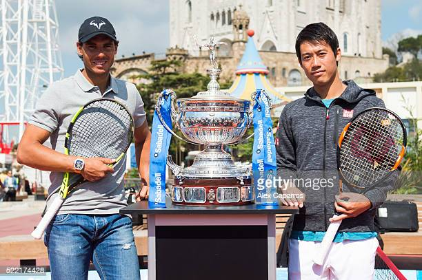 Rafael Nadal and Kei Nishikori pose with the Barcelona Open Banc Sabadell trophy during a promotional event ahead of the Barcelona Open Banc Sabadell...
