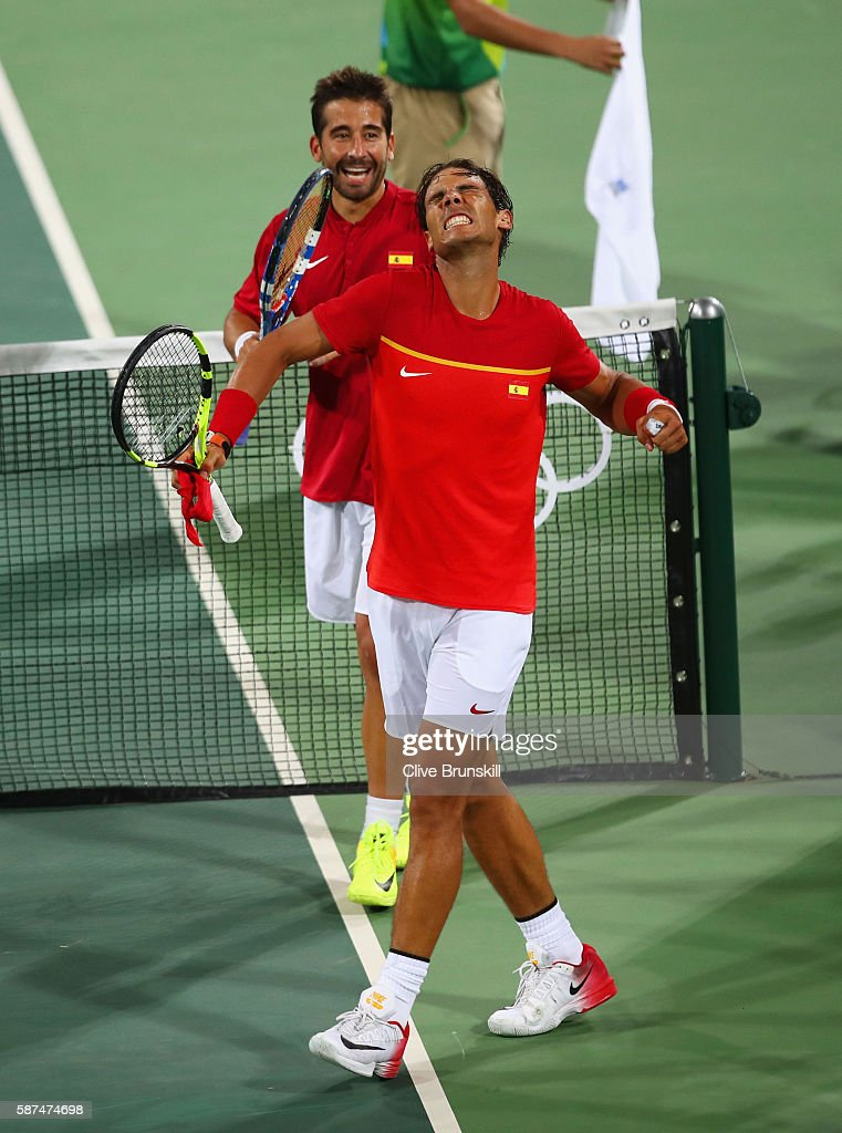 Rafael Nadal and Marc Lopez of Spain celebrate victory during the Men's Doubles second round match on against Juan Martin Del Potro and Maximo Gonzalez of Argentina Day 3 of the Rio 2016 Olympic Games at the Olympic Tennis Centre on August 8, 2016 in Rio de Janeiro, Brazil.