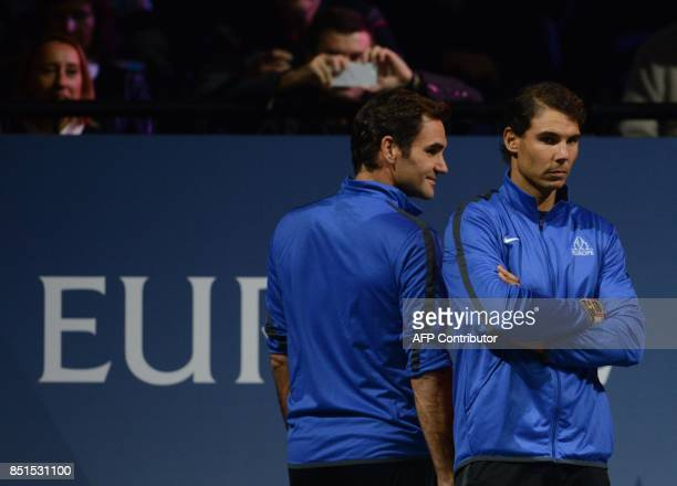 Rafael Nadal and Roger Federer members of Team Europa react during the match between Austrian Dominic Thiem and John Isner of United States and Team...