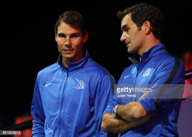 Rafael Nadal and Roger Federer of Team Europe watch the singles match between Dominic Thiem of Team Europe and John Isner of Team World on the first...
