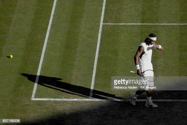 Rafael Nadal casts a shadow in his match against Irakli Labadze