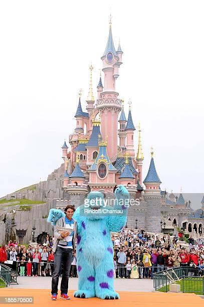 Rafael Nadal celebrates his record eighth French Open title at Disneyland Resort Paris on June 10 2013 in Paris France