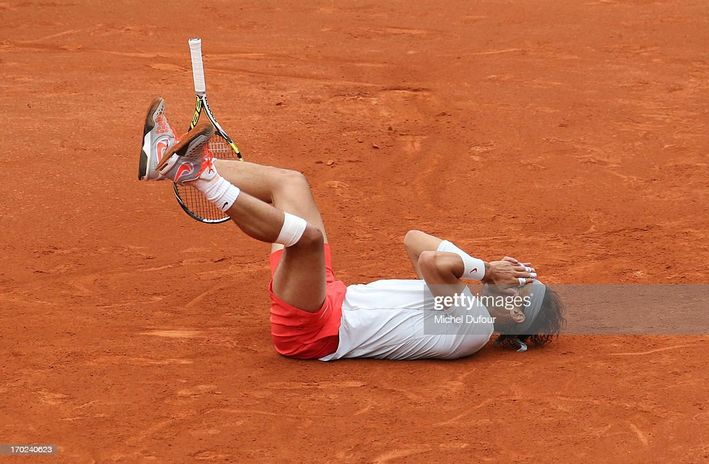 <a gi-track='captionPersonalityLinkClicked' href=/galleries/search?phrase=Rafael+Nadal&family=editorial&specificpeople=194996 ng-click='$event.stopPropagation()'>Rafael Nadal</a> during match point At French Open 2013 - Day 15 at Roland Garros on June 9, 2013 in Paris, France.