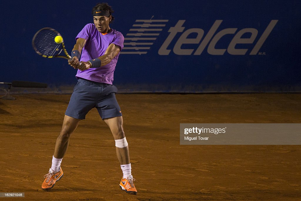 <a gi-track='captionPersonalityLinkClicked' href=/galleries/search?phrase=Rafael+Nadal&family=editorial&specificpeople=194996 ng-click='$event.stopPropagation()'>Rafael Nadal</a> from Spain in action during a tennis match against Lorenzo Mayer from Argentina as part of the Mexican Tennis Open Acapulco 2013 at Pacific resort on February 28, 2013 in Acapulco, Mexico.