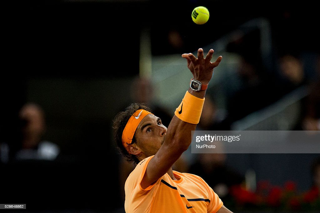Rafael Nadal from Spain returns a ball while playing against Joao Sousa from Portugal, during a Madrid Open tennis tournament match in Madrid, Spain, Friday, May 6, 2016. Rafael Nadal won 6-0, 4-6 and 6-3