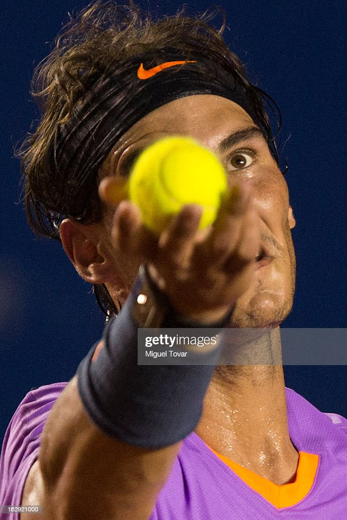 Rafael Nadal from Spain serves during a tennis match against Lorenzo Mayer from Argentina as part of the Mexican Tennis Open Acapulco 2013 at Pacific resort on February 28, 2013 in Acapulco, Mexico.