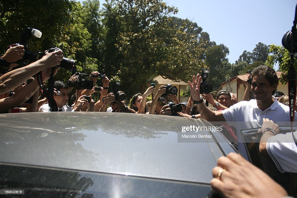 <a gi-track='captionPersonalityLinkClicked' href=/galleries/search?phrase=Rafael+Nadal&family=editorial&specificpeople=194996 ng-click='$event.stopPropagation()'>Rafael Nadal</a> greets his fans after the press conference after the draw of doubles and singles for VTR Open 2013 on February 2, 2013 in Viña del Mar, Chile.