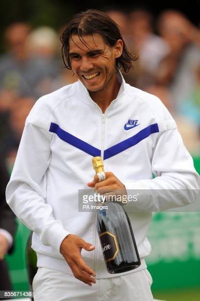 Rafael Nadal holds a bottle of champenge beating Stanislas Wawrinka during the BNP Paribas Fortis Tennis Classic at the Hurlingham Club London