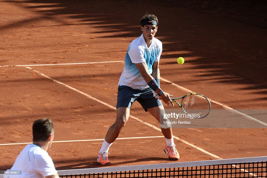 <a gi-track='captionPersonalityLinkClicked' href=/galleries/search?phrase=Rafael+Nadal&family=editorial&specificpeople=194996 ng-click='$event.stopPropagation()'>Rafael Nadal</a> in action during a double tennis match between <a gi-track='captionPersonalityLinkClicked' href=/galleries/search?phrase=Rafael+Nadal&family=editorial&specificpeople=194996 ng-click='$event.stopPropagation()'>Rafael Nadal</a> and Juan Mónaco against Frantisek Cermak and Lukas Dlouhya of Czechoslovak as part of the day 1 of the ATP Viña del Mar VTR Open 2013 on February 05, 2013 in Viña del Mar, Chile.