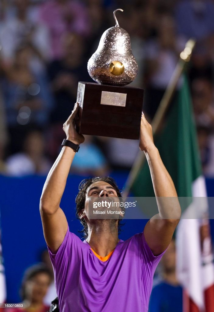 <a gi-track='captionPersonalityLinkClicked' href=/galleries/search?phrase=Rafael+Nadal&family=editorial&specificpeople=194996 ng-click='$event.stopPropagation()'>Rafael Nadal</a> lifts up his trophy after winning the final round match against David Ferrer at the ATP Mexican Open Telcel on March 2, 2013 in Acapulco, Mexico.