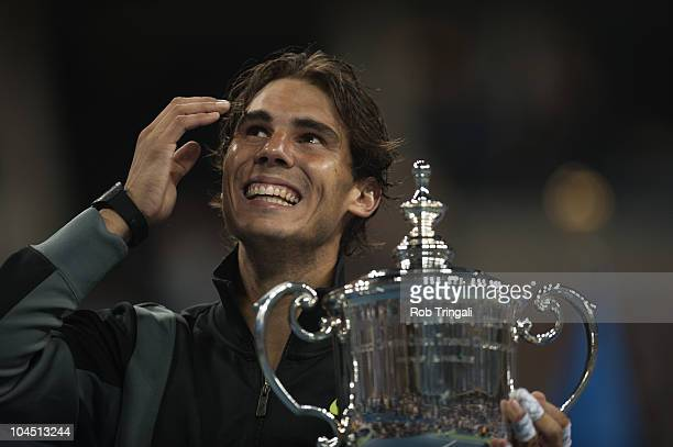 Rafael Nadal looks on with the US Open Trophy after defeating Novak Djokovic in the men's final on day fifteen of the 2010 US Open at the USTA Billie...