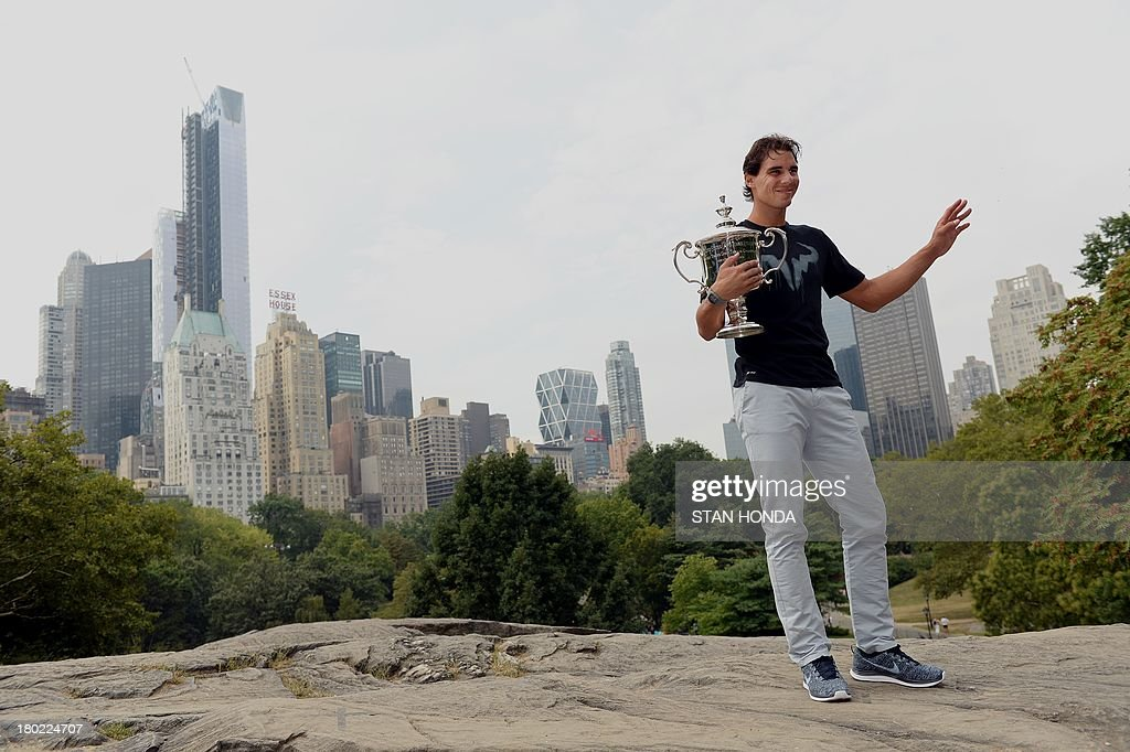 Rafael Nadal of Spain, 2013 US Open tennis mens singles champion, holds the trophy as he poses September 10, 2013 in New York's Central Park. AFP PHOTO/Stan HONDA