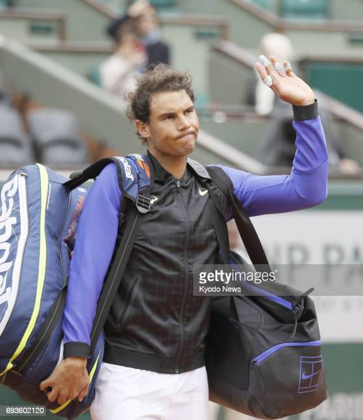 Rafael Nadal of Spain acknowledges the crowd after his win over compatriot Pablo Carreno Busta in a French Open quarterfinal match in Paris on June 7...