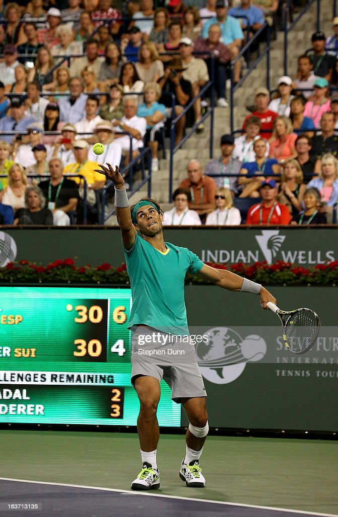 <a gi-track='captionPersonalityLinkClicked' href=/galleries/search?phrase=Rafael+Nadal&family=editorial&specificpeople=194996 ng-click='$event.stopPropagation()'>Rafael Nadal</a> of Spain aerves to Roger Federer of Switzerland during day 9 of the BNP Paribas Open at Indian Wells Tennis Garden on March 14, 2013 in Indian Wells, California. Nadal won 6-4, 6-2.