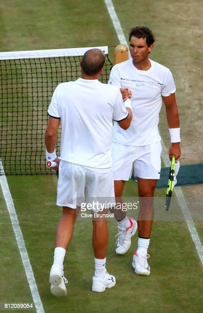 Rafael Nadal of Spain and Gilles Muller of Luxembourg shake hands after their Gentlemen's Singles fourth round match on day seven of the Wimbledon...