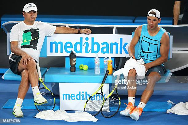 Rafael Nadal of Spain and his coach Toni Nadal looks on during a practice session ahead of the 2017 Australian Open at Melbourne Park on January 13...